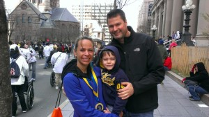 Laura, her husband, Andy, and oldest son, Liam, after the Boston 2013 Marathon